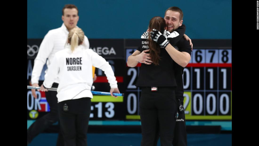 Anastasia Bryzgalova and Aleksandr Krushelnitckii, curling athletes from Russia, celebrate after defeating Norway for a bronze medal.