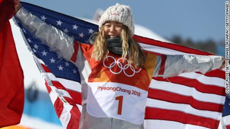 PYEONGCHANG-GUN, SOUTH KOREA - FEBRUARY 13:  Gold medalist Chloe Kim of the United States celebrates during the victory ceremony for the Snowboard Ladies' Halfpipe Final on day four of the PyeongChang 2018 Winter Olympic Games at Phoenix Snow Park on February 13, 2018 in Pyeongchang-gun, South Korea.  (Photo by Clive Rose/Getty Images)