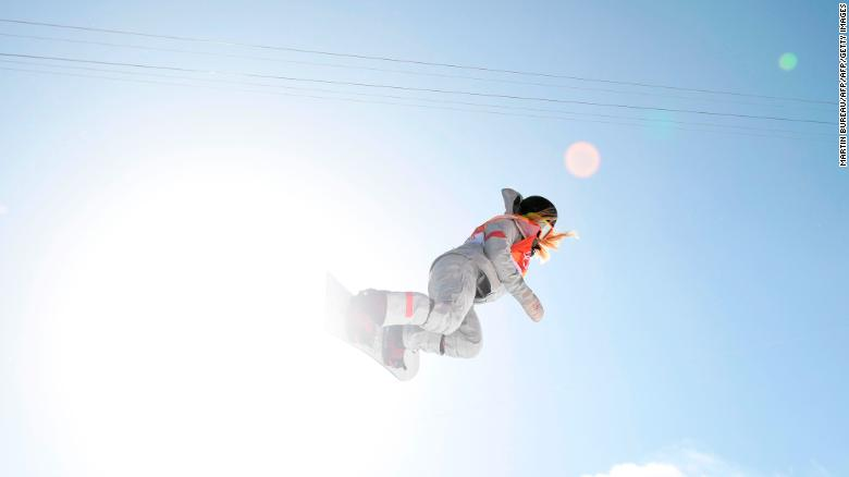 USA's Chloe Kim competes in run two of the women's snowboard half pipe final event at Phoenix Park.