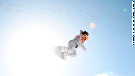 Chloe Kim competes in the women's snowboard halfpipe final.