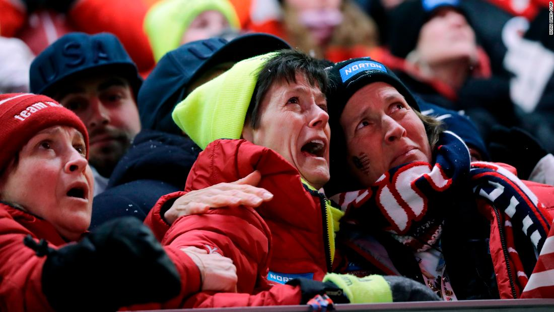 Sue Sweeney, center, reacts to her daughter's crash in the luge.