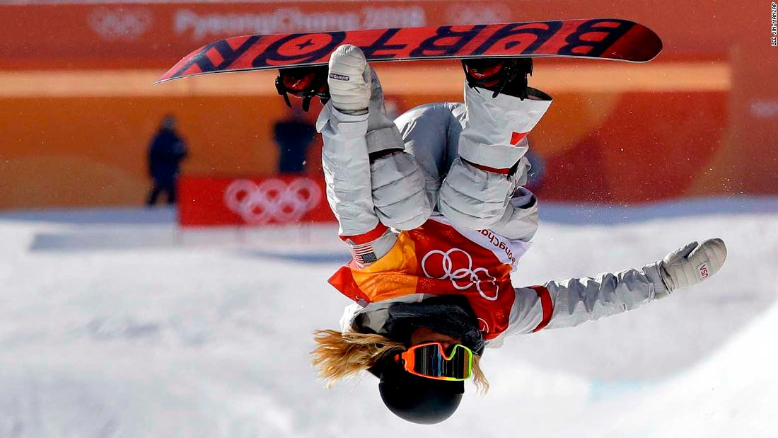 American snowboarder Chloe Kim competes on the halfpipe. Kim, 17, posted the two highest scores of the finals, earning gold with a near-perfect score of 98.25.
