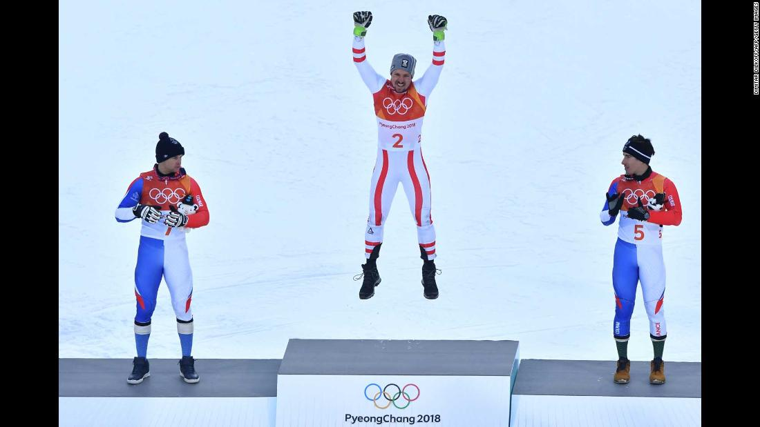 Austrian skier Marcel Hirscher celebrates on the podium after winning his first Olympic gold medal. The six-time world champion held off France's Alexis Pinturault, left, and Victor Muffat-Jeandet in the combined.