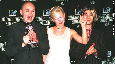 Billy Corgan, D'arcy Wretzky and James Iha of The Smashing Pumpkins win Video of the Year at the 1996 MTV Video Music Awards.