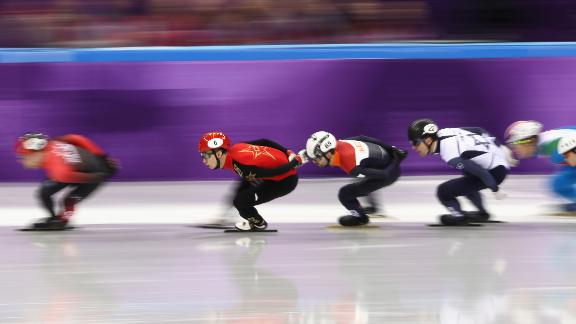 GANGNEUNG, SOUTH KOREA - FEBRUARY 10: Dajing Wu of China, Itzhak De Laat of the Netherlands and Vladislav Bykanov of Israel compete during the Men's 1500m Short Track Speed Skating qualifying on day one of the PyeongChang 2018 Winter Olympic Games at Gangneung Ice Arena on February 10, 2018 in Gangneung, South Korea.  (Photo by Jamie Squire/Getty Images)