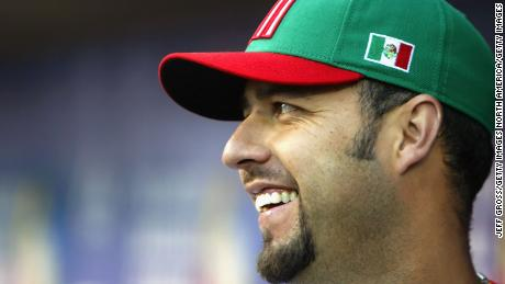 ANAHEIM, CA - MARCH 16:  Pitcher Esteban Loaiza #21 of Team Mexico smiles in the dugout during the Round 2 Pool 2 Game of the World Baseball Classic against Team USA at Angel Stadium on March 16, 2006 in Anaheim, California. Mexico defeated USA, 2-1.  (Photo by Jeff Gross/Getty Images)