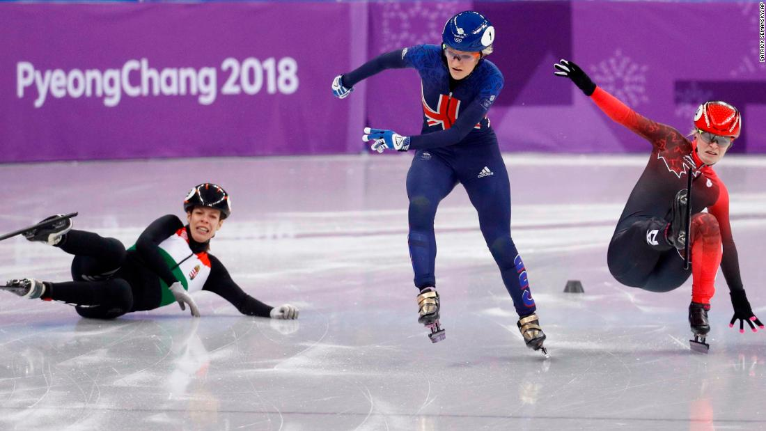 British speedskater Elise Christie, center, races past Hungary's Andrea Keszler, left, and Canada's Kim Boutin during a 500-meter short-track quarterfinal.