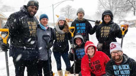 People respond to social media call to shovel snow for the elderly in Chatham, South Side of Chicago.