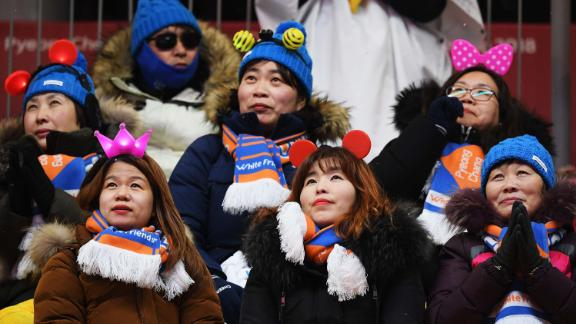 Fans look on at the luge women