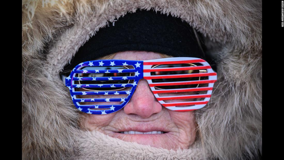 A woman shows her support for the United States during the men's halfpipe qualification.