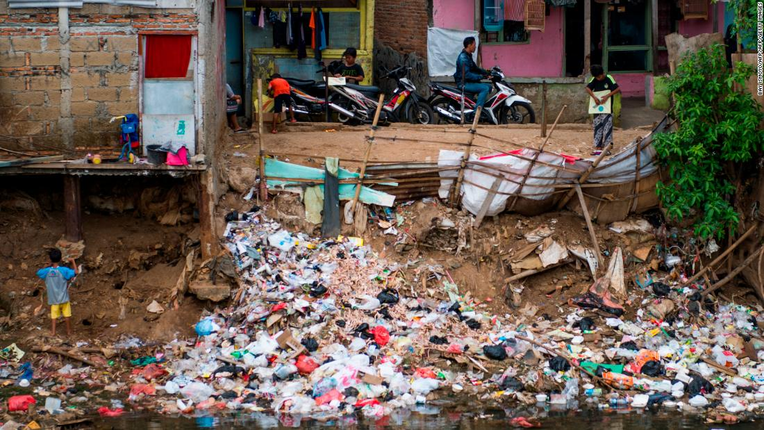 Trash thrown into a riverbank at a slum in Jakarta on January 10, 2018.