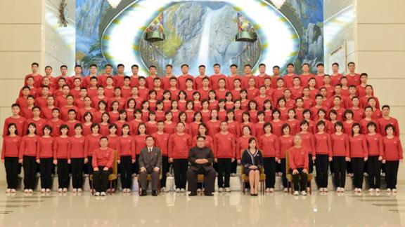 North Korea's leader Kim Jong Un met and had a photo session with the members of the Samjiyon Orchestra which returned home after successful congratulatory art performances for the 23rd Winter Olympics in the south side's region.