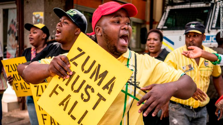Supporters of ANC Deputy President Cyril Ramaphosa chant slogans outside the ANC party headquarters in Johannesburg, February 5, 2018.