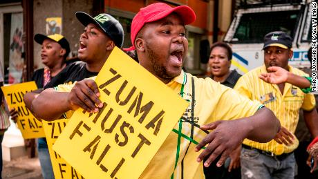 Supporters of ANC leader Cyril Ramaphosa chant slogans outside the party headquarters in Johannesburg on February 5.