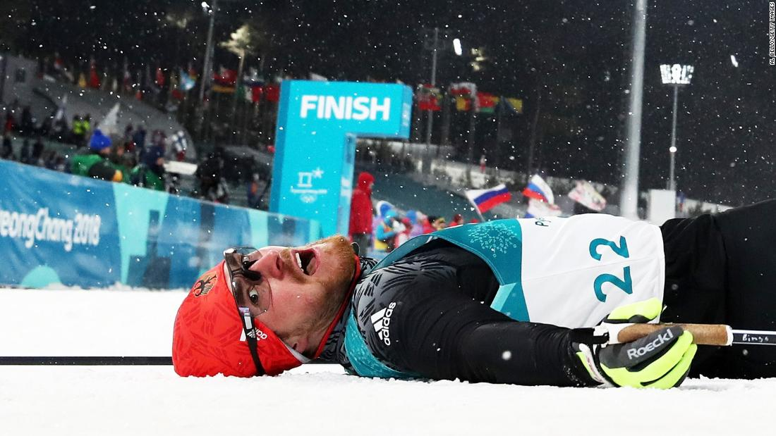 Germany's Thomas Bing lies on the snow after a cross-country skiing race.