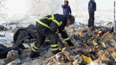 "This handout photo taken and released by the Russian Emergency Ministry on February 13, 2018, shows emergency rescuers working at the site of plane crash in Ramensky district, on the outskirts of Moscow. The Antonov An-148 plane went down in the Ramensky district around 70 kilometres (44 miles) southeast of Moscow after taking off from Domodedovo airport in the Russian capital and disappearing off the radar at 2:28 pm (1128 GMT) on February 11. ""Sixty-five passengers and six crew members were on board, and all of them died,"" Russia's office of transport investigations said in a statement. / AFP PHOTO / RUSSIAN EMERGENCY MINISTRY / Handout / RESTRICTED TO EDITORIAL USE - MANDATORY CREDIT ""AFP PHOTO / RUSSIAN EMERGENCY MINISTRY"" - NO MARKETING NO ADVERTISING CAMPAIGNS - DISTRIBUTED AS A SERVICE TO CLIENTS  HANDOUT/AFP/Getty Images"