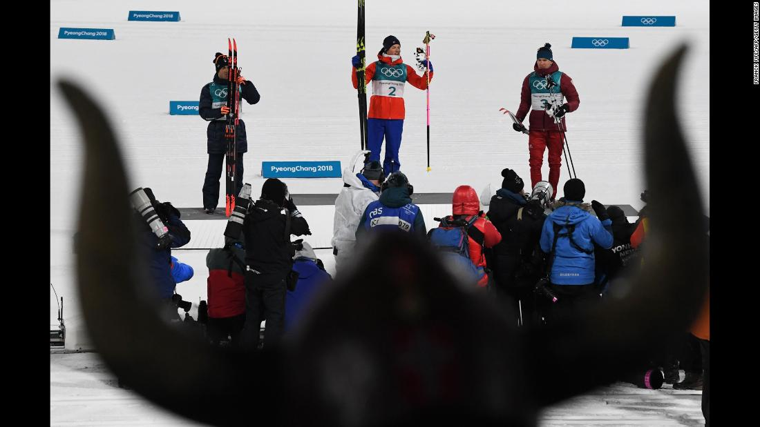 Norway's Johannes Hoesflot Klaebo won gold in a cross-country sprint. Italy's Federico Pellegrino, left, earned the silver. Alexander Bolshunov, from Russia, took the bronze.