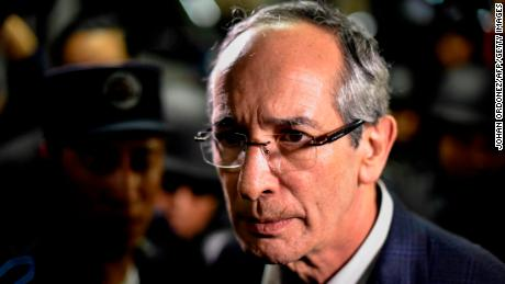 Former Guatemalan President Alvaro Colom is detained on corruption charges in Guatemala City on Tuesday.