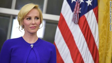 Louise Linton, the fiancee of newly sworn-in Treasury Secretary Steven Mnuchin, watches as speaks after taking the oath of office in the Oval Office of the White House on February 13, 2017 in Washington, DC.