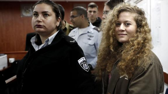 Ahed Tamimi (R) stands for the beginning of her trial on Tuesday.