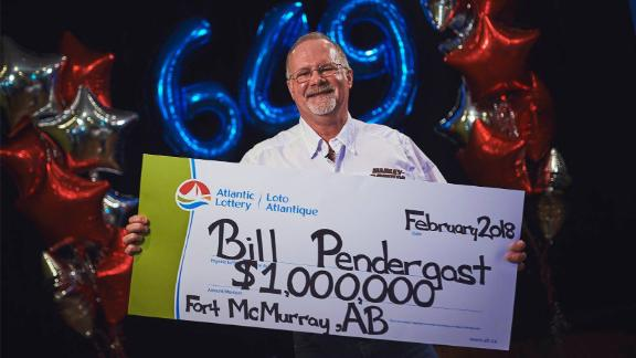 Bill Pendergast was presented with his lottery winnings on Friday.