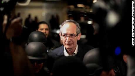 Former Guatemalan President Alvaro Colom (C) is arrested on corruption charges in Guatemala City on February 13, 2018.  Guatemalan authorities on Tuesday arrested a former president and nine ministers of his former government on corruption charges, a top prosecutor told AFP. Colom, 66, was put under detention in his home in an upmarket district of the capital, the head of the special anti-graft prosecution unit, Juan Francisco Sandoval, said. The allegations against him and his former ministers related to graft in the public transport system. / AFP PHOTO / JOHAN ORDONEZ        (Photo credit should read JOHAN ORDONEZ/AFP/Getty Images)
