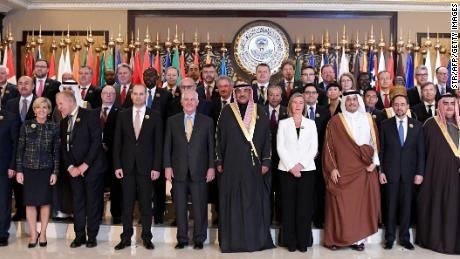 Kuwaiti Foreign Minister Sheikh Sabah al-Khaled al-Sabah, US Secretary of State Rex Tillerson, EU Foreign Policy Chief Frederica Mogherini, Qatari Foreign Minister Sheikh Mohammed bin Abdulrahman al-Thani, Afghan Foreign Minister Salahuddin Rabbani and Bahrain's Foreign Minister Sheikh Khalid bin Ahmed al-Khalifa pose with other officials for a group photo in Kuwait City.