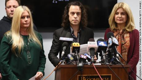 Alexander Polinsky speaks during a press conference with  Nicole Eggert (L) and his attorney Lisa Bloom regarding sexual harassment allegations against Scott Baio.