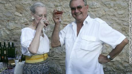 Prince Henrik enjoys a drink with Queen Margrethe at their summer residence in Caix, France, 2006.