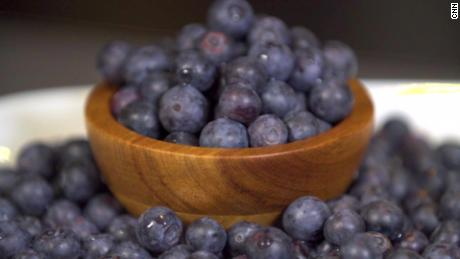 The fiber in cup of berries, such as blueberries, will help fill you up.