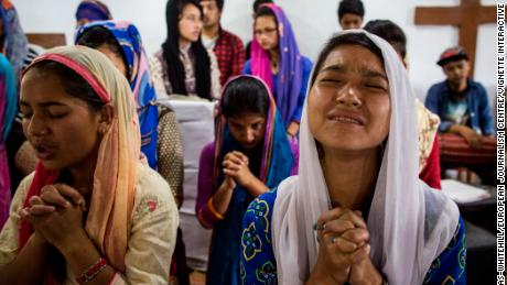 Nepalese Christians pray during a weekly church service in a small village of Tikhatal, in the Dolakha region of Nepal.