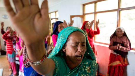 Nepalese Christians dance, sing and pray during a weekly church service in a small village of Tikhatal, in the Dolakha region of Nepal, 2017.