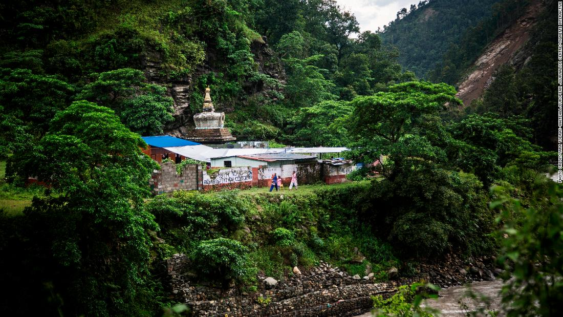 Nepalese Christians walk nearby a small Christian church and Hindu stupa after a lecture by Soman Rai, a pastor who founded the non-profit Voice of Fetus Nepal, in the village of Shilaprabat, Sindhupalcholk district, Nepal, 2017.