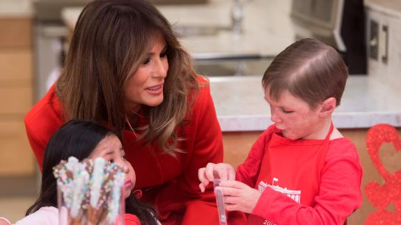 Melania Trump decorates cookies for Valentine's Day as she visits with children who are currently patients at the National Institutes of Health (NIH) at The Children's Inn at NIH in Bethesda, Maryland.