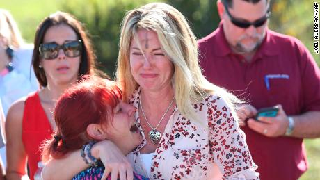 Parents wait for news after reports of the shooting at Marjory Stoneman Douglas High School.