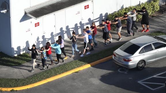 Students evacuate the school.