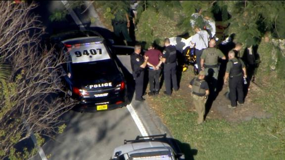 The suspect, 19-year-old former student Nikolas Cruz, is taken into custody by authorities. Cruz was apprehended off of the campus.