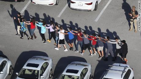Students file out of the school. Many were afraid the shooter was still a threat.