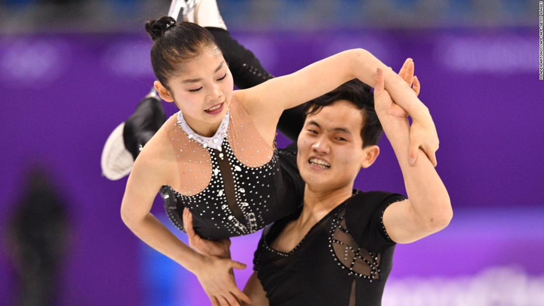 North Korean figure skaters Ryom Tae Ok and Kim Ju Sik compete in the pairs event.