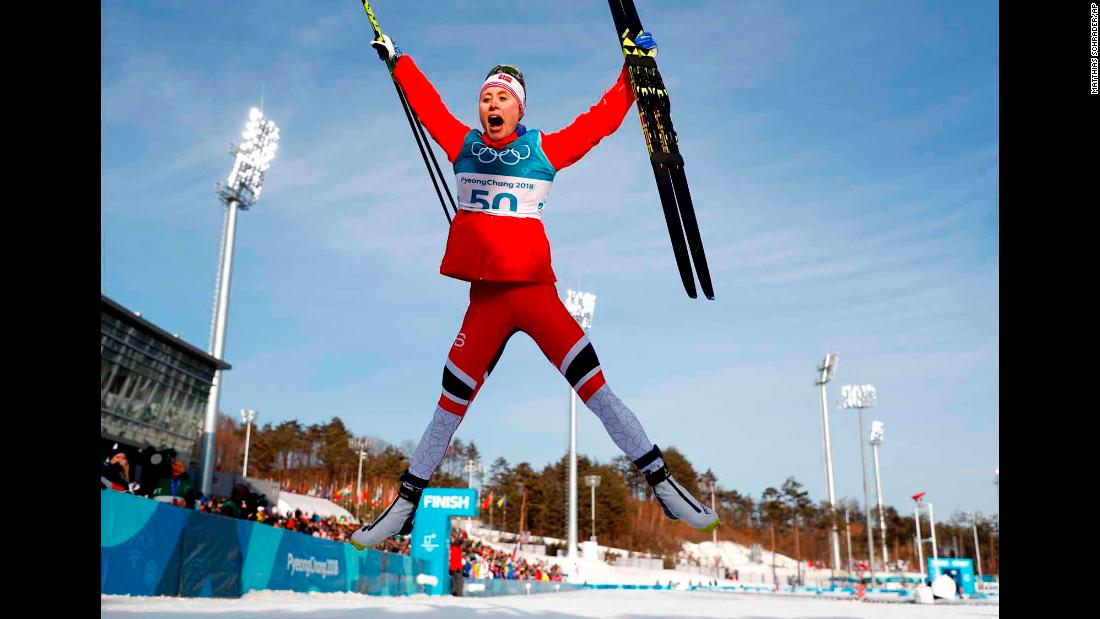 Norwegian cross-country skier Ragnhild Haga celebrates after winning gold in the 10-kilometer freestyle.