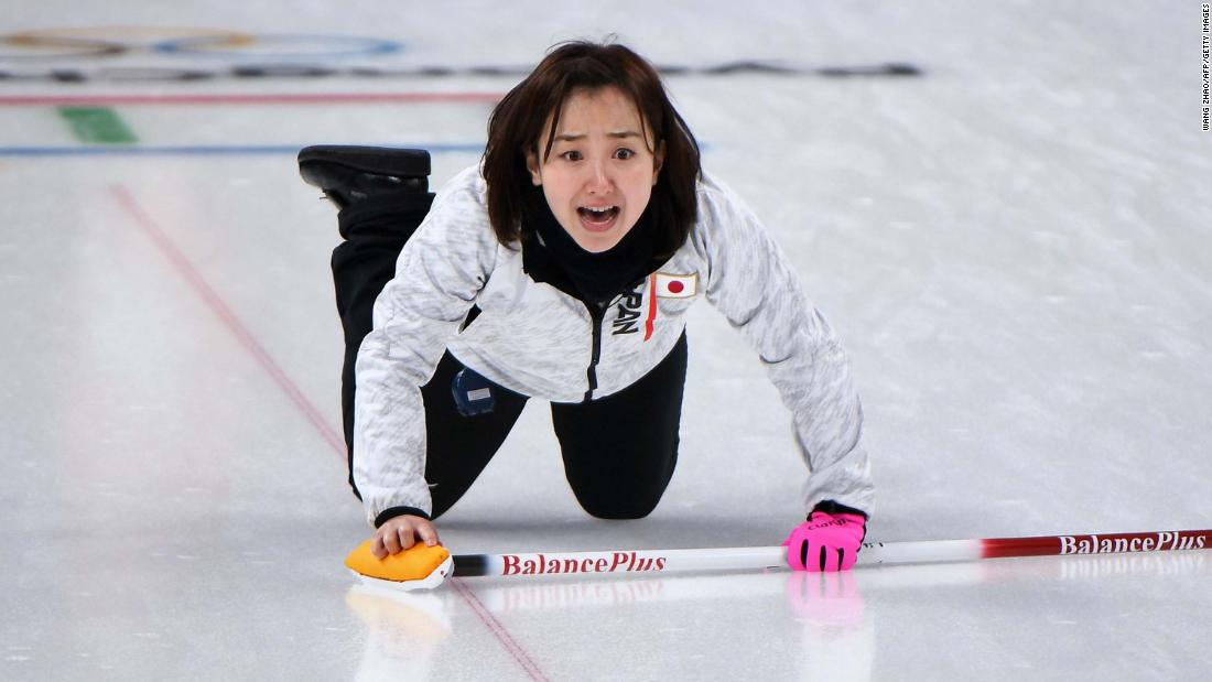 Japan's Satsuki Fujisawa shouts for instructions during a curling match against Denmark.