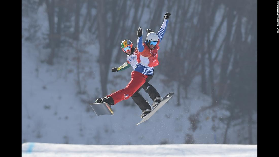 France's Pierre Vaultier, front, leads Australia's Jarryd Hughes during the final of snowboard cross. Vaultier won gold for the second straight Olympics.