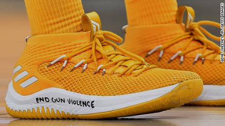 "Utah Jazz player Donovan Mitchell wears shoes with ""End Gun Violence"" written on them during a game against the Phoenix Sun Wednesday night in Salt Lake City, Utah."