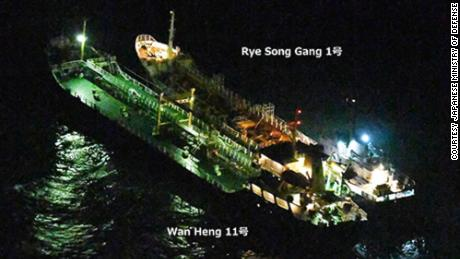 "This image released by Japanese authorities shows the Rye Song Gang 1, a North Korean vessel, beside a Belizean-flagged ship. The Japanese government ""strongly suspects"" an illicit ship-to-ship transfer took place"