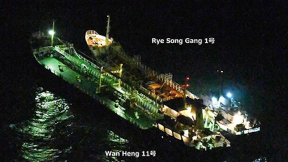 """This image released by Japanese authorities shows the Rye Song Gang 1, a North Korean vessel, beside a Belizean-flagged ship. The Japanese government """"strongly suspects"""" an illicit ship-to-ship transfer took place"""