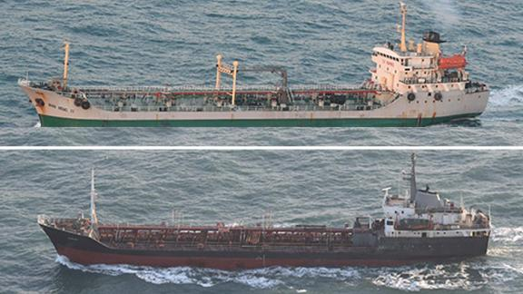 The Rye Song Gang 1 (bottom) and the Wan Heng 11 (top) sailing after sunrise on Tuesday.