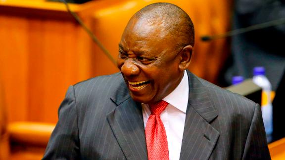 Acting President of South Africa Cyril Ramaphosa reacts as he arrives at Parliament in Cape Town, on February 15, 2018 for a session to officially deal with former President Zuma's resignation and his possible election and swearing.South Africa prepared to welcome wealthy former businessman Cyril Ramaphosa as its new president on February 15, 2018 after scandal-tainted Jacob Zuma resigned under intense pressure from his own party. / AFP PHOTO / POOL / MIKE HUTCHINGS        (Photo credit should read MIKE HUTCHINGS/AFP/Getty Images)