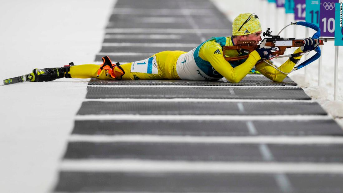 Sweden's Fredrik Lindstrom fires his rifle during the 20-kilometer biathlon.