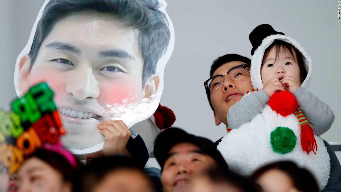 A spectator holds a picture of South Korean speedskater Lee Seung-hoon during the 10,000 meters.