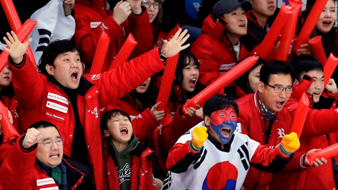South Koreans cheer on speedskater Lee Seung-hoon during the 10,000 meters. He finished in fourth.